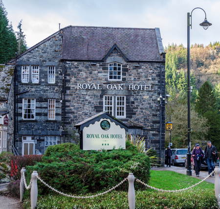 Betws y Coed, UK - Feb 2, 2019: The Royal Oak Hotel in Betws y Coed provides dining & accomodation to travellers and tourists. A former coaching inn, the hotel is located on the historic A5 road. Editorial