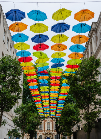 Liverpool, UK: Aug 3, 2018: Umbrellas form a suspended canopy in Church Alley, Liverpool. The umbrellas are intended to raise awareness of ADHD. This location has become popular with tourists.