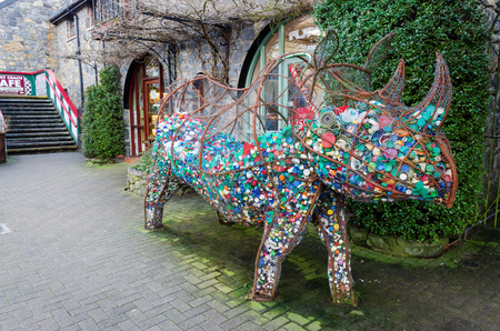 Betws y Coed, UK - Feb 2, 2019: Edith the Rhino is a community art project to highlight the plight of rhinos. The wireframe sculpture at Betws y Coed station is filled with waste plastic bottle tops.