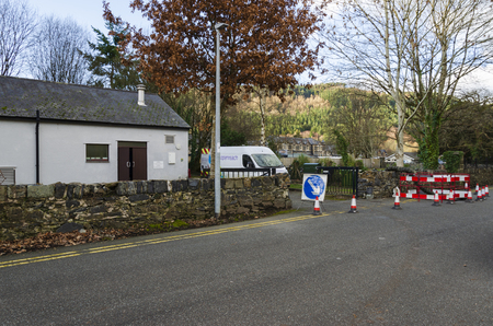 Betw-y-Coed, UK. Feb 2, 2019. Barriers surround maintenance works outside a BT Openreach telephone exchange. Editorial