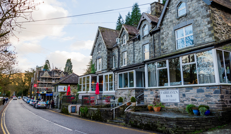 Betws y Coed, UK - Feb 2, 2019: General street scene in Betws-y-Coed. The main road through Betws-y-Coed is lined with shops, guest houses, hotels & restaurants popular with tourists.