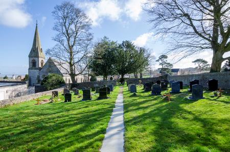 Gorsedd, UK - Mar 25, 2019: The High Gothic parish church of St. Paul in the North Wales village of Gorsedd. Designed by the architect Thomas Henry Wyatt.