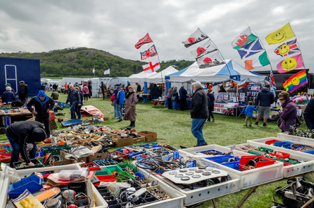Llandudno, UK - May 5, 2019: Visitors to the Llandudno Transport Festival 2019 enjoy the displays and exhibits. The Llantransfest is held in conjunction with the annual Victorian Extravaganza.