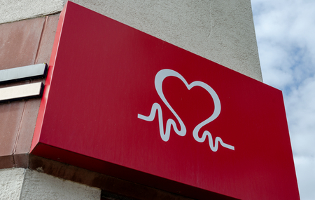 Llandudno, UK - May 6, 2019: Sign above the Llandudno branch of the British Heart Foundation Home Store. The charity shop specialises in used furniture, household appliances and electrical goods. Editorial