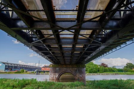 A railway and foot bridge which crosses the River Dee in Flintshire, North Wales. The bridge is often called the Hawarden Bridge.