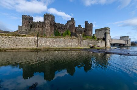 The metal box railway bridge at the side of Conwy Castle crosses the River Conwy. The castle was built by King Edward I and the bridge was designed by Robert Stephenson
