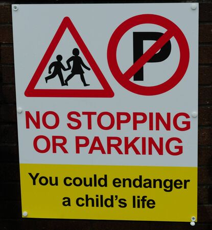 A road sign which prohibits stopping or parking in order to avoid endangering a child's life.
