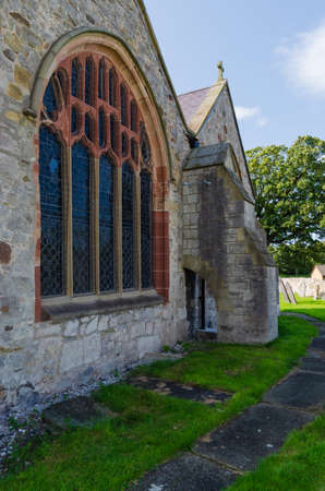 Abergele, UK: Aug 19, 2019:St. Michael's Church in Abergele is a medieval church. It has an unusual Victorian flying buttress which supports the junction between the east walls of the two chancels.