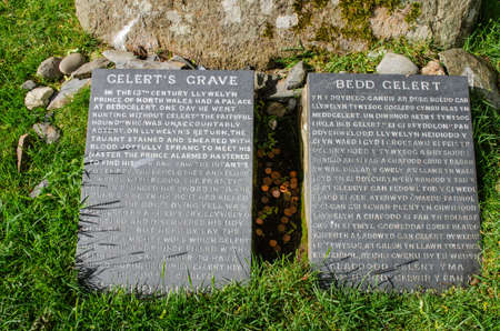 Beddgelert, North Wales, UK: Jun 3, 2017: A pair of inscribed slates mark the supposed grave of Gelert who was a faithful dog and main character of local folklore. Editöryel