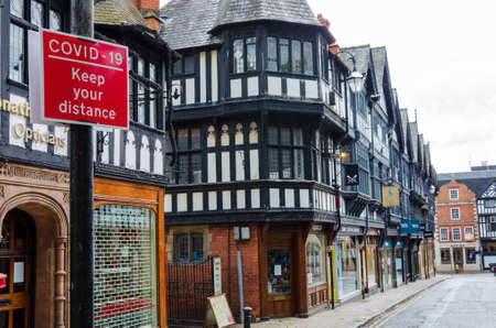 Chester, UK: Jun 14, 2020: A general street scene of Chester City centre showing some traffic & pedestrian restrictions which have been put in place to allow social distancing due to Covid-19 pandemic