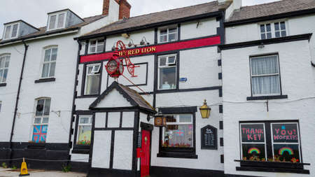 Parkgate, Wirral, UK: Jun 17, 2020: The Red Lion public house which is temporarily closed due to the coronavirus pandemic has window displays thanking the NHS and key workers. Editorial