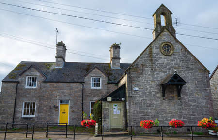 Llandegla, UK: Sept 20, 2020: The Llandegla Community Village Shop was once the village school. Unusually, the building has a small wooden bell canopy on the gable wall. 에디토리얼