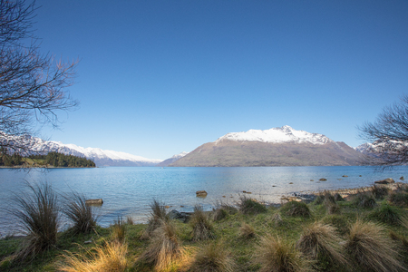 Queenstown, South Island, New Zealand looking over Lake Wakatipu with The Remarkables in the distance. Stock Photo