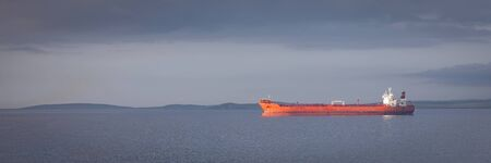 A ship leaving from Lerwick, The Shetland Islands, in Scotland.