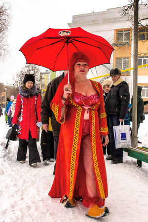 plunge: UFABASHKORTOSTAN RUSSIA 22nd February 2015 - A woman in Red prepares to plunge into Ice cold water for Maslenitsa