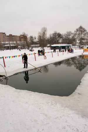 maslenitsa: UFABASHKORTOSTAN RUSSIA 22nd February 2015 - the Ice Cold waters offer the swimmers a chilling experience for Maslenitsa