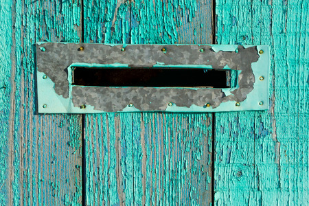 Metal letter box on painted blue wood photo