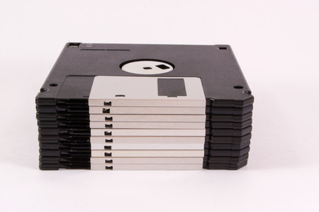 Old retro style floppy discs isolated on white photo