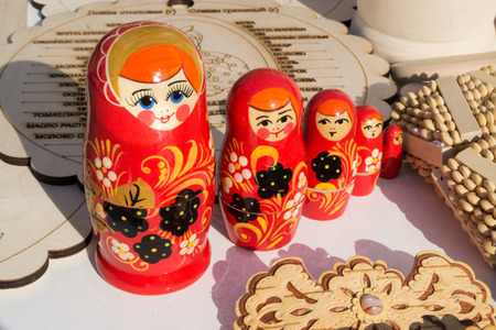implements: Red Russian nesting dolls with wood carving accessories and implements Stock Photo
