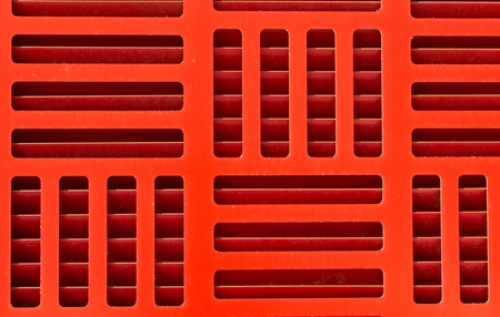 vents: Alternating red grill pattern with visible vents and shadows Stock Photo