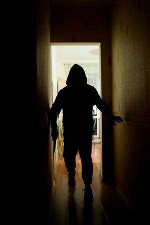 invader: A murderer man creeps in the dark with a knife Stock Photo