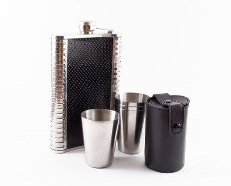 shooters: A leather hip flask and four metal travel shot glasses and a black leather case