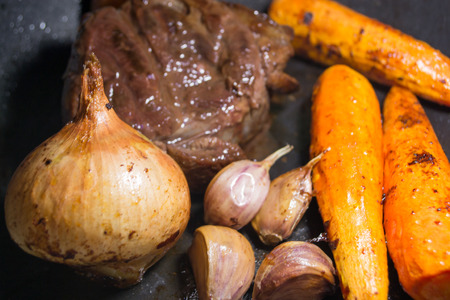 booked: Oven glazed booked beef and veg in juices with herbs