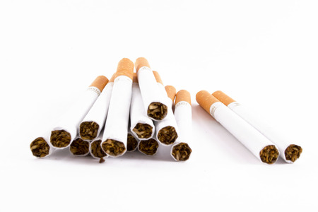 unlit: A pile of unlit cigs isolated on white in closeup Stock Photo