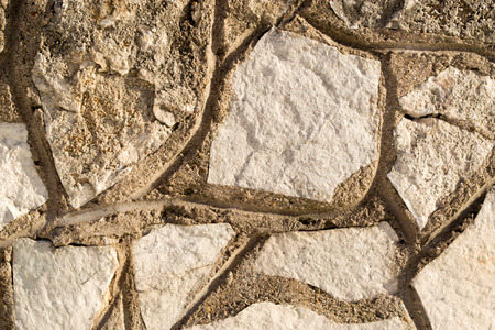 walling: Closeup detail of a rock wall built from stone and cement Stock Photo