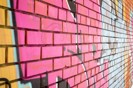 vandal: A pink wall with cement bricks and perspective