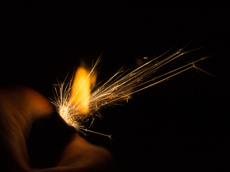 hand held: Sparks from a hand held ligther in the dark
