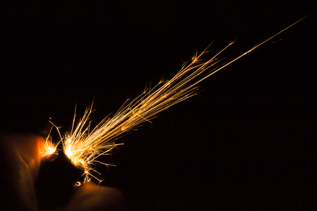 Sparks from a hand held ligther in the dark photo