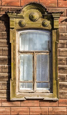 fading: A fading green painted ornate Russian window frame on a public house