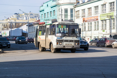 street shot: A street shot of a Russian bus on a road forming an essential transport service for the public Editorial