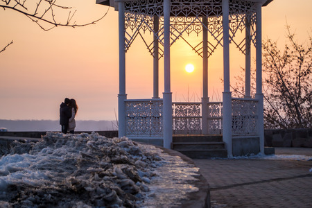 sweethearts: Two young sweethearts embrace as the winter sun begins to set