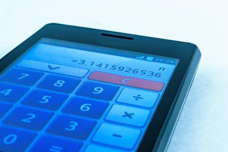 decimal: A mobile smart phone displays the symbol of Pi 3.14 on its calculator