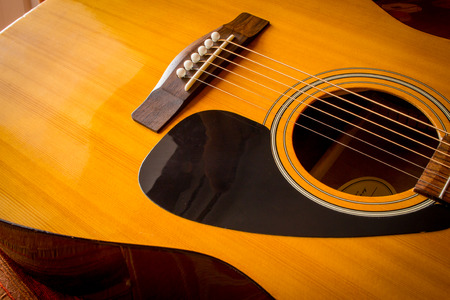 Large acoustic guitar with sound hole and pickguard photo
