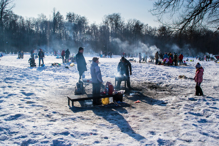 barbecues: UFABASHKORTOSTAN RUSSIA - 7th March 2015 - The Russian public enjoying individual shashlik barbecues in the winter snow of an open park Editorial