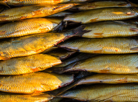 dozen: Pattern effect of a dozen smoked mackerel at the market Stock Photo