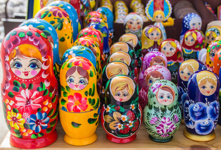 matriosca: Rows of the Russian puzzle nesting dolls in various colours Stock Photo