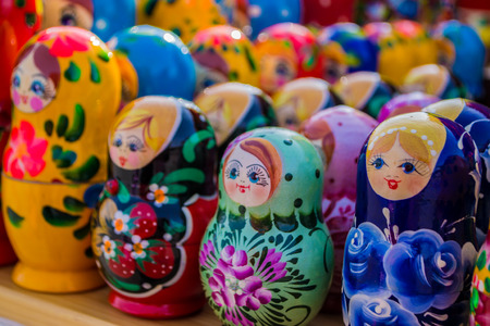 Colorful rows of russian puzzle dolls in different colors and designs photo