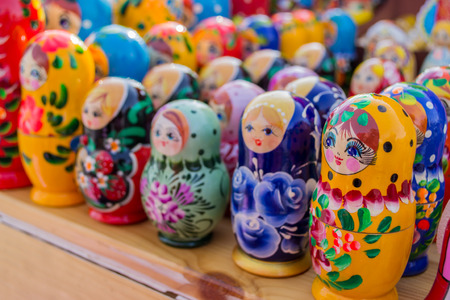 Colourful wooden nesting dolls from Russia in different colors photo