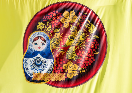 matriosca: A matrushka puzzle doll flag from Russia in yellow silk
