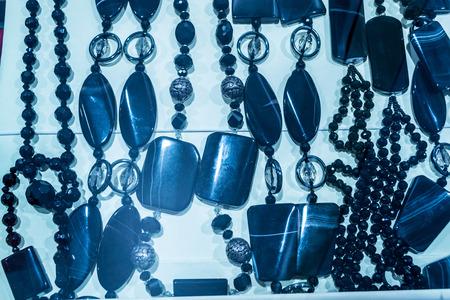 black onyx: A display of black onyx semi precious stone necklaces Stock Photo