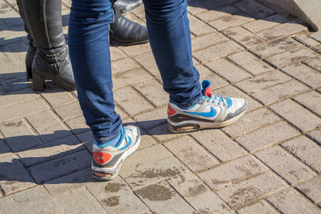 17th of march: UFABASHKORTOSTAN - RUSSIA - 17th March 2015 - A young girl parades in her popular trendy trainers Editorial