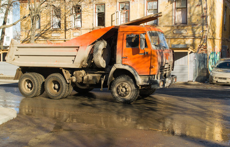 17th of march: UFABASHKORTOSTAN - RUSSIA - 17th March 2015 - A Orange Kamaz delivers timber to a new bulding site Editorial