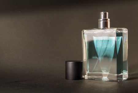 aftershave: An unused fresh bottle of aftershave with a black lid Stock Photo