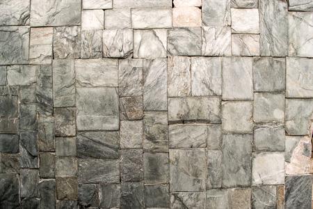 masonary: Perfectly aligned stones create a rock wall construction in grey Stock Photo
