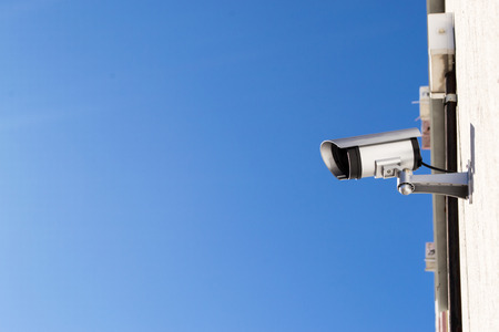 residential housing: A CCTV camera attached to a residential housing wall Stock Photo