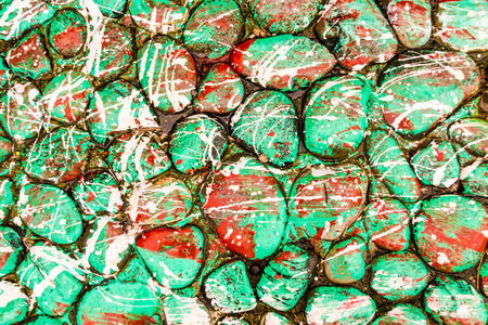 distinctive: Stones covered in paint drops and drips creating a distinctive splatter pattern Stock Photo